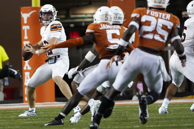 UTEP's Gavin Hardison (12) looks to pass against Texas during the first half of an NCAA college football game in Austin, Texas, Saturday, Sept. 12, 2020. (AP Photo/Chuck Burton)