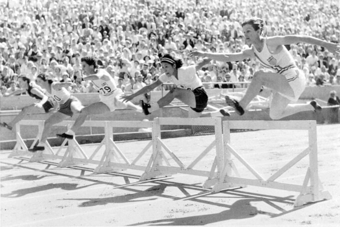 """FILE - In this Aug. 3, 1932, file photo, Mildred """"Babe"""" Didrikson, right, of Dallas, clears the first hurdle on her way winning the first heat of the 80-meter hurdles in 11.8 seconds, breaking the Olympic record of 12.2 second, at the Olympics in Los Angeles. (AP Photo/File)"""