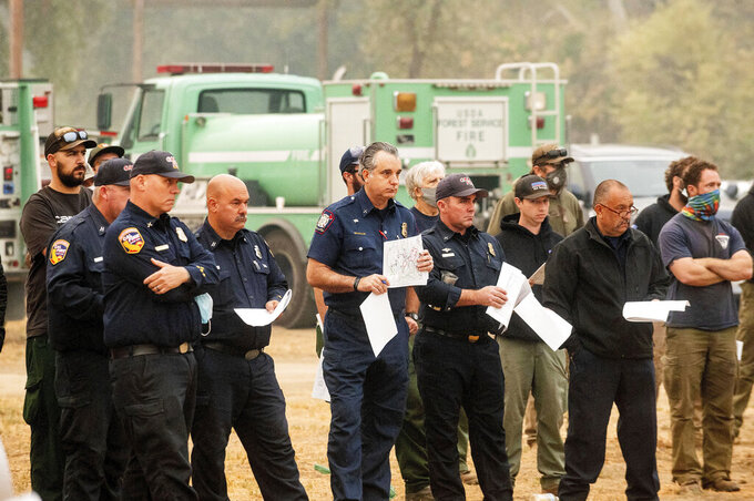 Firefighters attend a morning briefing in the Three Rivers community of Tulare County, Calif., while battling the KNP Complex Fire on Thursday, Sept. 16, 2021. (AP Photo/Noah Berger)