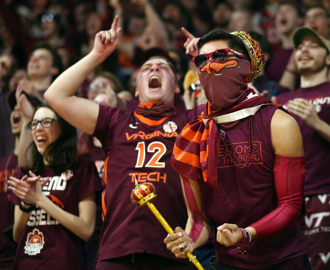 "Virginia Tech fans in the student section ""Cassell Guard"" at the start of the team's NCAA college basketball game against Virginia on Wednesday, Feb. 26, 2020, in Blacksburg, Va. (Matt Gentry/The Roanoke Times via AP)"