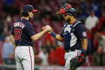 Washington Nationals' Kyle Finnegan, left, and Keibert Ruiz celebrate their win over the Cincinnati Reds at the end of a baseball game Thursday, Sept. 23, 2021, in Cincinnati. The Nationals beat the Reds 3-2. (AP Photo/Jay LaPrete)