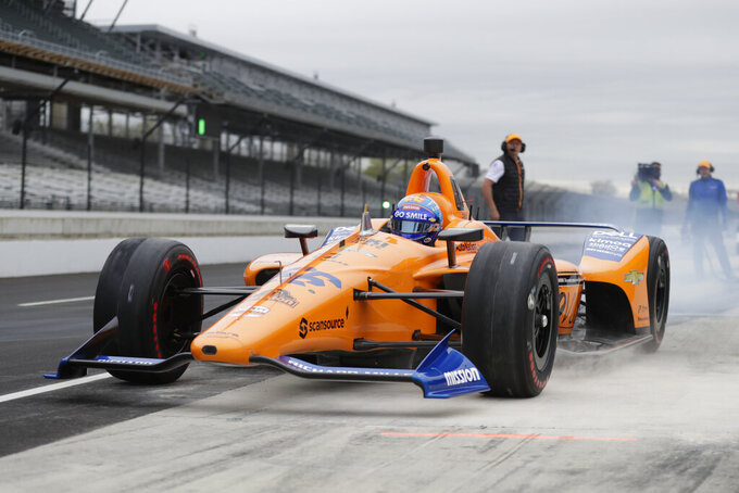 FILE - In this April 24, 2019, file photo, IndyCar driver Fernando Alonso, of Spain, drives out of the pit area during testing at the Indianapolis Motor Speedway in Indianapolis. Alonso feels far better about his chances to close out motorsports' version of the Triple Crown this year. The Spaniard will race for Arrow McLaren SP in the Indianapolis 500 and believes the organization is prepared. (AP Photo/Michael Conroy, File)