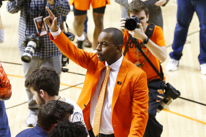 Oklahoma State head coach Mike Boynton Jr. waves to the crowd after his team defeated Oklahoma in an NCAA college basketball game in Stillwater, Okla., Saturday, Feb. 22, 2020. (AP Photo/Sue Ogrocki)