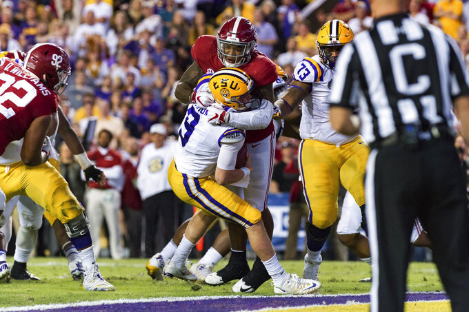 LSU quarterback Joe Burrow is sacked by Alabama linebacker Anfernee Jennings in an NCAA college football game in Lafayette, La., Saturday, Nov. 3, 2018. (Scott Clause/The Daily Advertiser via AP)