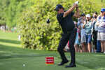 Phil Mickelson tees off on the 18th hole during the third round of the Wells Fargo Championship golf tournament at Quail Hollow on Saturday, May 8, 2021, in Charlotte, N.C. (AP Photo/Jacob Kupferman)