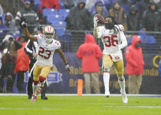 San Francisco 49ers defensive back Marcell Harris (36) runs after to recovering the ball from Baltimore Ravens quarterback Lamar Jackson who fumble it in the second half of an NFL football game, Sunday, Dec. 1, 2019, in Baltimore, Md. With Harris is teammate cornerback Ahkello Witherspoon (23). (AP Photo/Julio Cortez)