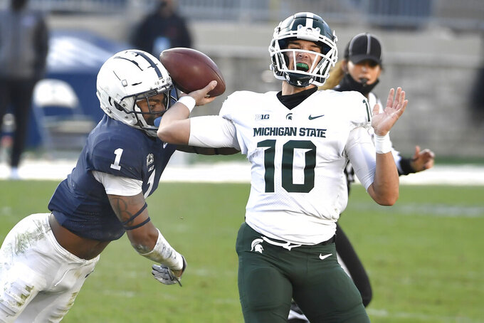 Penn State safety Jaquan Brisker (1) pressures Michigan State quarterback Payton Thorne (10) in the fourth quarter of an NCAA college football game in State College, Pa., on Saturday, Dec. 12, 2020. (AP Photo/Barry Reeger)