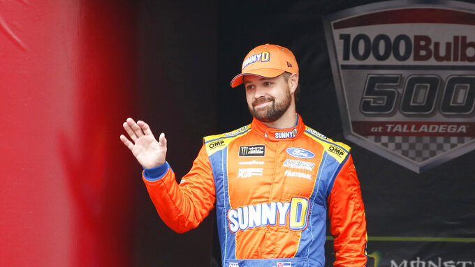 Monster Energy NASCAR Cup Series driver Ricky Stenhouse Jr. (17) waves at driver introductions during a NASCAR Cup Series auto race at Talladega Superspeedway, Sunday, Oct. 14, 2019, in Talladega, Ala. (AP Photo/Butch Dill)