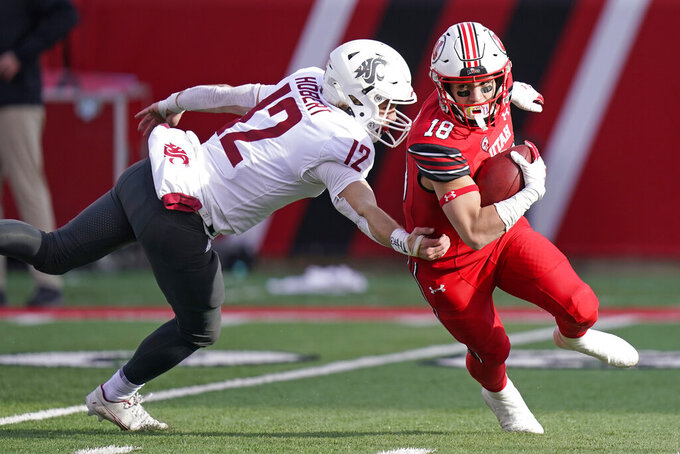 Utah wide receiver Britain Covey (18) breaks free from Washington State wide receiver Joey Hobert (12) tackle during the second half of an NCAA college football game Saturday, Dec. 19, 2020, in Salt Lake City. (AP Photo/Rick Bowmer)