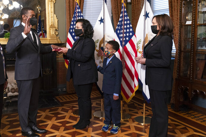 Vice President Kamala Harris, right, administers the ceremonial swearing-in of Michael Regan as EPA administrator in the Vice President's Ceremonial Office at the Eisenhower Executive Office Building on the White House complex in Washington, Wednesday, March 17, 2021. With EPA Administrator Regan are his wife Melvina Thomas Regan, son Matthew Silas, 7. (AP Photo/Manuel Balce Ceneta)