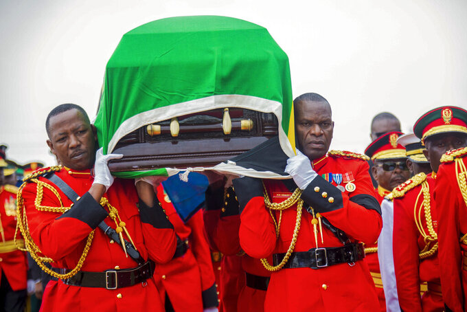 Military officers carry the coffin of former President John Magufuli, draped with the national flag, during a funeral service in his home town of Chato, Tanzania, Friday, March 26, 2021.  Some thousands have gathered in the northwestern town of Chato for the burial of former Tanzanian President John Magufuli whose denial of COVID-19 brought the country international criticism. (AP Photo)