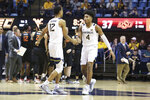 West Virginia guards Taz Sherman (12) and Miles McBride (4) congratulate one another during the second half of the team's NCAA college basketball game against Oklahoma State on Tuesday, Feb. 18, 2020, in Morgantown, W.Va. (AP Photo/Kathleen Batten)