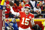 FILE - In this Dec. 30, 2018, file photo, Kansas City Chiefs quarterback Patrick Mahomes (15) throws a touchdown pass to wide receiver Demarcus Robinson, unseen, during the second half of an NFL football game against the Oakland Raiders, in Kansas City, Mo. Mahomes made The Associated Press 2018 NFL All-Pro Team, Friday, Jan. 4, 2018. (AP Photo/Charlie Riedel, File)