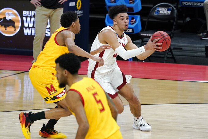 Alabama's Jaden Shackelford, right, drives to the basket against Maryland during the first half of a college basketball game in the second round of the NCAA tournament at Bankers Life Fieldhouse in Indianapolis Monday, March 22, 2021. Shackelford scored 21 points as Alabama won 96-77. (AP Photo/Mark Humphrey)