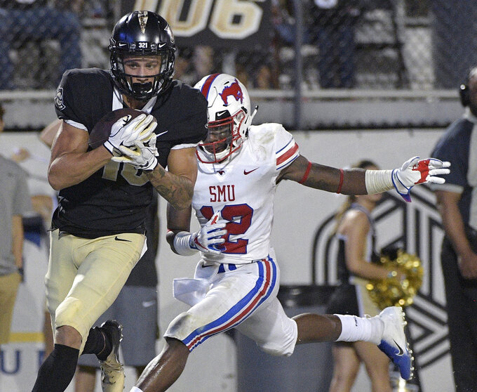Central Florida wide receiver Tre Nixon, left, catches a pass in front of SMU cornerback Kevin Johnson (12) for a 30-yard touchdown during the second half of an NCAA college football game Saturday, Oct. 6, 2018, in Orlando, Fla. UCF won 48-20. (AP Photo/Phelan M. Ebenhack)