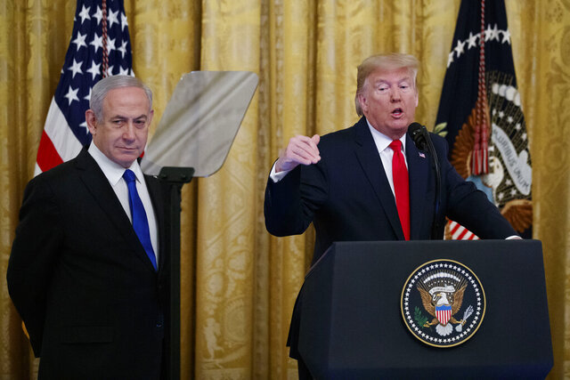 President Donald Trump speaks during an event with Israeli Prime Minister Benjamin Netanyahu in the East Room of the White House in Washington, Tuesday, Jan. 28, 2020, to announce the Trump administration's much-anticipated plan to resolve the Israeli-Palestinian conflict. (AP Photo/Alex Brandon)