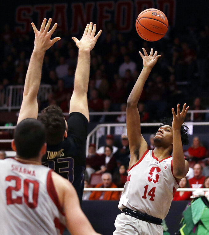 Stanford's Marcus Sheffield, right, shoots against Washington's Sam Timmins in the first half of an NCAA college basketball game Sunday, March 3, 2019, in Stanford, Calif. (AP Photo/Ben Margot)