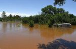 Uncle John Creek is overflowing it's banks in Kingfisher, Okla., Tuesday May 21, 2019. (Billy Hefton/Enid News & Eagle via AP)