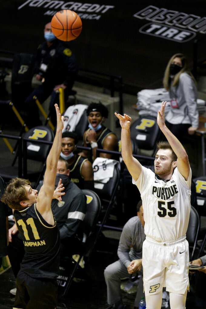Purdue guard Sasha Stefanovic (55) goes up for three against Oakland guard Blake Lampman (11) during the first half of an NCAA college basketball game Tuesday, Dec. 1, 2020 in West Lafayette, Ind. (Nikos Frazier/Journal & Courier via AP)