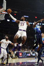 Los Angeles Lakers' LeBron James (23) drives to the basket against the Dallas Mavericks during the first half of an NBA basketball game Sunday, Dec. 1, 2019, in Los Angeles. (AP Photo/Marcio Jose Sanchez)