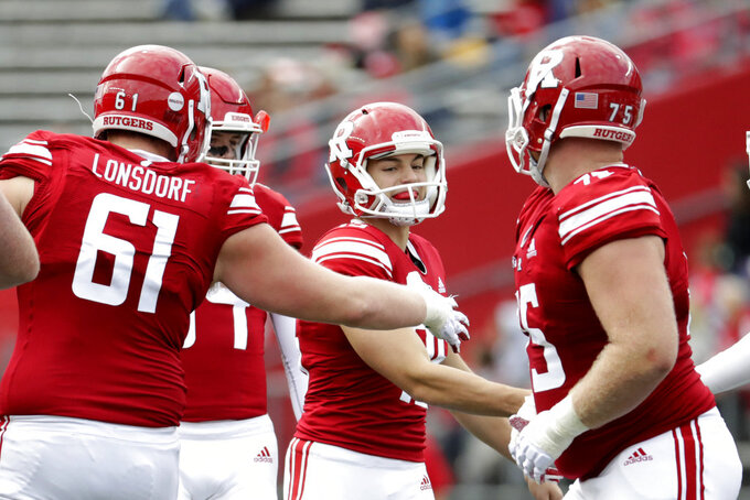 Rutgers place kicker Justin Davidovicz, center, is congratulated by teammates after kicking a field goal against Northwestern during the first half of an NCAA college football game, Saturday, Oct. 20, 2018, in Piscataway, N.J. (AP Photo/Julio Cortez)