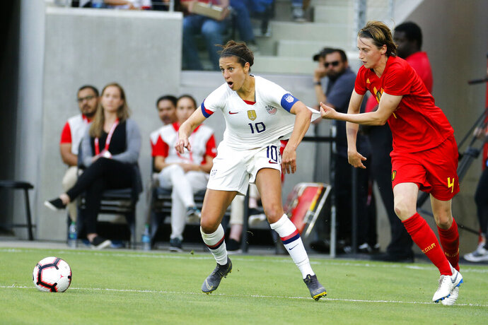Belgium defender Heleen Jaques (4) grabs United States forward Carli Lloyd (10) during the first half of their international friendly soccer match Sunday, April 7, 2019, in Los Angeles. (AP Photo/Ringo H.W. Chiu)