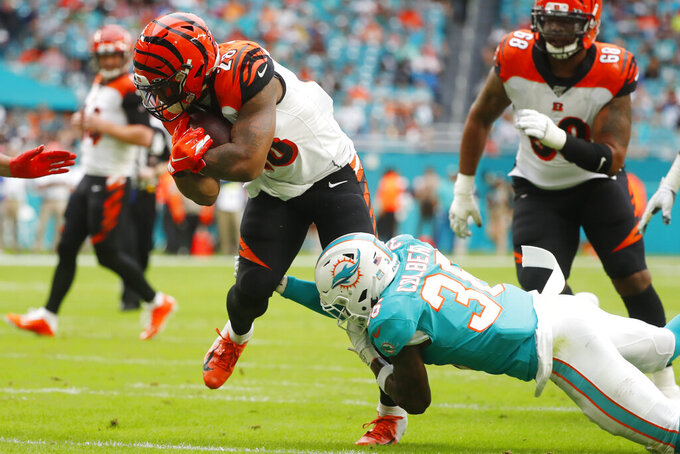 Miami Dolphins free safety Adrian Colbert (36) tackles Cincinnati Bengals running back Joe Mixon (28), during the first half at an NFL football game, Sunday, Dec. 22, 2019, in Miami Gardens, Fla. (AP Photo/Wilfredo Lee)