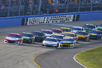 Kyle Larson, far left, and William Byron lead as Chase Elliott, front right, goes low to try to pass during a NASCAR Cup Series auto race Sunday, June 20, 2021, in Lebanon, Tenn. (AP Photo/John Amis)