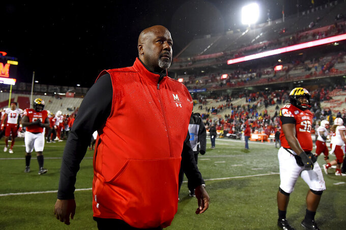 Maryland head coach Mike Locksley walks off the field after losing to Nebraska in an NCAA college football game, Saturday, Nov. 23, 2019, in College Park, Md. (AP Photo/Will Newton)