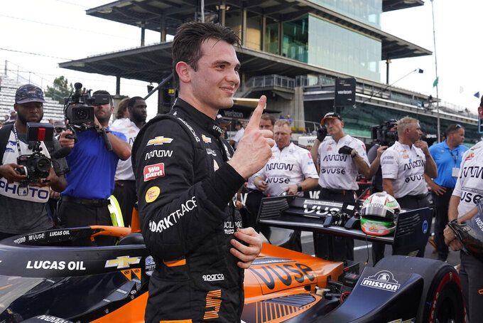 Pato O'Ward, of Mexico, reacts after winning the pole for an IndyCar auto race at Indianapolis Motor Speedway, Friday, Aug. 13, 2021, in Indianapolis. (AP Photo/Darron Cummings)