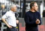Dortmund's head coach Lucien Favre, left and Munich's head coach Hansi Flick, right, attend the German Bundesliga soccer match between Borussia Dortmund and FC Bayern Munich in Dortmund, Germany, Tuesday, May 26, 2020. The German Bundesliga is the world's first major soccer league to resume after a two-month suspension because of the coronavirus pandemic. (Federico Gambarini/DPA via AP, Pool)