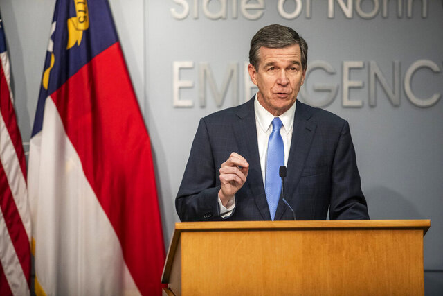 Gov. Roy Cooper speaks during a briefing on North Carolina's coronavirus pandemic response at the NC Emergency Operations Center, Tuesday, Jan. 12, 2021, in Raleigh, N.C. (Travis Long/The News & Observer via AP)