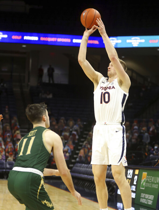 Virginia forward Sam Hauser (10) shoots over William & Mary guard Thornton Scott (11) during an NCAA college basketball  game Tuesday, Dec. 22, 2020, in Charlottesville, Va. (Andrew Shurtleff/The Daily Progress via AP)