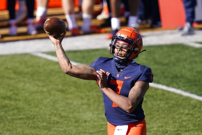 Illinois quarterback Coran Taylor passes during the first half of an NCAA college football game against Purdue Saturday, Oct. 31, 2020, in Champaign, Ill. (AP Photo/Charles Rex Arbogast)