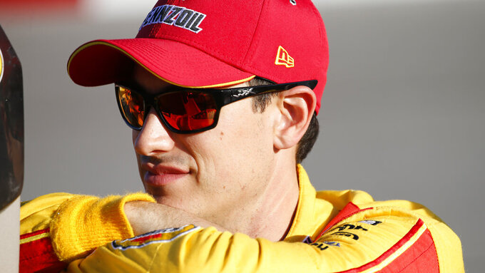 Joey Logano waits in the pits for qualifying for the NASCAR Monster Energy Cup series auto race at Richmond Raceway in Richmond, Va., Saturday, Sept. 21, 2019. (AP Photo/Steve Helber)