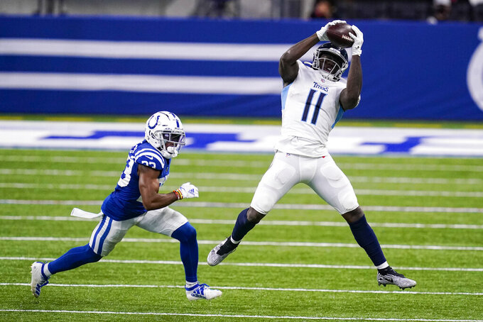 Tennessee Titans wide receiver A.J. Brown (11) makes a catch in front of Indianapolis Colts cornerback Kenny Moore II (23) in the second half of an NFL football game in Indianapolis, Sunday, Nov. 29, 2020. (AP Photo/Darron Cummings)