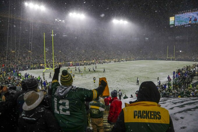 Fans cheer in the final seconds of the second half of an NFL football game between the Green Bay Packers and the Carolina Panthers at Lambeau Field Sunday, Nov. 10, 2019, in Green Bay, Wis. The Packers won 24-16. (AP Photo/Morry Gash)