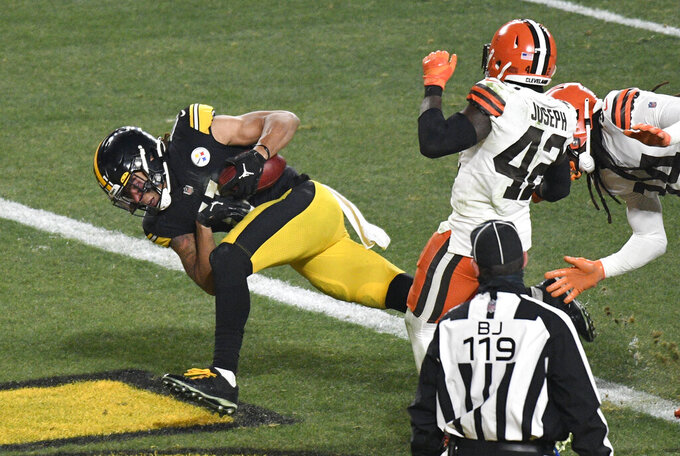 Pittsburgh Steelers wide receiver Chase Claypool (11) scores on a 40-yard pass play with Cleveland Browns strong safety Karl Joseph (42) and Robert Jackson (34) defending during the second half of an NFL wild-card playoff football game in Pittsburgh, Sunday, Jan. 10, 2021. (AP Photo/Don Wright)