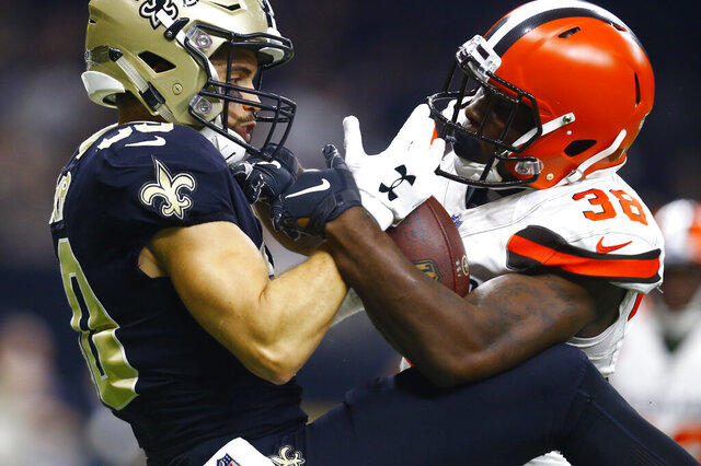 FILE - In this Sept. 16, 2018, file photo, New Orleans Saints wide receiver Austin Carr, left, cannot hold on to the football as Cleveland Browns defensive back T.J. Carrie (38) defends during the first half of an NFL football game in New Orleans. New Browns general manager Andrew Berry cleared $13 million in salary-cap space Monday, Feb. 17, 2020, by releasing veteran cornerback Carrie and three others players signed by former GM John Dorsey. (AP Photo/Butch Dill, File)