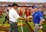 Iowa State head coach Matt Campbell, left, shakes hands with South Dakota State head coach John Stiegelmeier, before the NCAA college football game, Saturday, Sept. 1, 2018, in Ames, Iowa. (AP Photo/Matthew Putney)