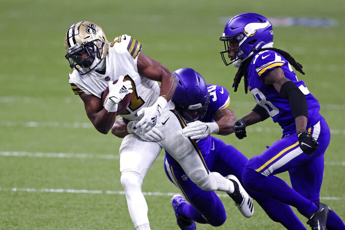 New Orleans Saints wide receiver Emmanuel Sanders (17) is tackled by Minnesota Vikings outside linebacker Eric Wilson and cornerback Harrison Hand (38) in the first half of an NFL football game in New Orleans, Friday, Dec. 25, 2020. (AP Photo/Butch Dill)