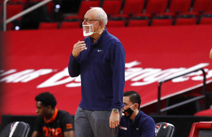 Syracuse head coach Jim Boeheim is not pleased with the call during the first half of an NCAA college basketball game against North Carolina State, Tuesday, Feb. 9, 2021 in Raleigh, N.C. (Ethan Hyman/The News & Observer via AP, Pool)