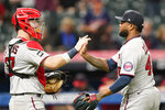 Minnesota Twins relief pitcher Alex Colome, right, is congratulated by catcher Ryan Jeffers after the Twins defeated the Cleveland Indians 5-2 in a baseball game, Monday, Sept. 6, 2021, in Cleveland. (AP Photo/Tony Dejak)