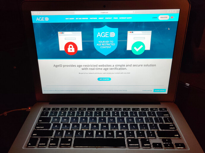 """This photo taken in London on Monday July 8, 2019, shows a laptop screen displaying the website for AgeID, an age verification system for the British government's planned online """"porn block"""