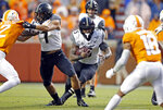 Vanderbilt running back Ke'Shawn Vaughn (5) runs for yardage in the first half of an NCAA college football game against Tennessee, Saturday, Nov. 30, 2019, in Knoxville, Tenn. (AP Photo/Wade Payne)