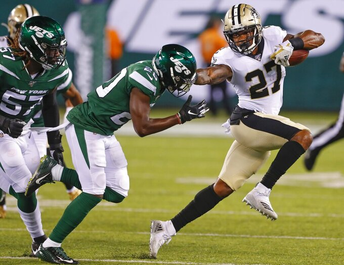 New Orleans Saints' Dwayne Washington (27) stiff-arms New York Jets' Marcus Maye (20) during the first half of a preseason NFL football game Saturday, Aug. 24, 2019, in East Rutherford, N.J. (AP Photo/Noah K. Murray)