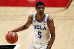 UCLA guard Chris Smith dribbles the ball during the second half of the team's NCAA college basketball game against Pepperdine, Friday, Nov. 27, 2020, in San Diego. (AP Photo/Gregory Bull)
