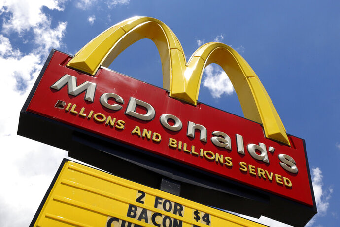 FILE - In this June 25, 2019 file photo a sign is displayed outside a McDonald's restaurant in Pittsburgh. McDonald's got tough on its former CEO, who was fired last week for having a consensual relationship with an employee. Now, some workers say, the company needs to get tougher on sexual harassment in its restaurants. On Tuesday, Nov. 12 former McDonald's employee Jenna Ries filed a class-action lawsuit against the company and one of its Michigan franchisees. Ries says she and female colleagues were subjected to repeated physical and verbal harassment.(AP Photo/Gene J. Puskar, File)