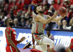 Houston's Galen Robinson Jr., right, heads to the basket past Ohio State's Keyshawn Woods during the first half of a second round men's college basketball game in the NCAA Tournament Sunday, March 24, 2019, in Tulsa, Okla. (AP Photo/Jeff Roberson)