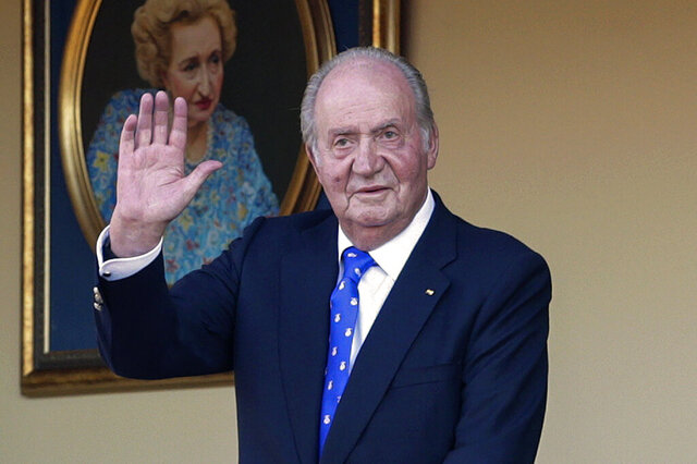 FILE - In this Sunday, June 2, 2019 file photo, Spain's former King Juan Carlos waves during a bullfight at the bullring in Aranjuez, Madrid, Spain. Spain's royal household said on Monday Aug. 17, 2020, that former monarch Juan Carlos is in the United Arab Emirates, resolving a mystery over his whereabouts that has swirled in Spain since he announced he was leaving the country amid a growing financial scandal. (AP Photo/Andrea Comas, File)